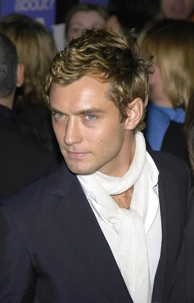 Jude Law looked classy and androgynous with his eye-catching curly blond hair with a tousled finish during the New York premiere of