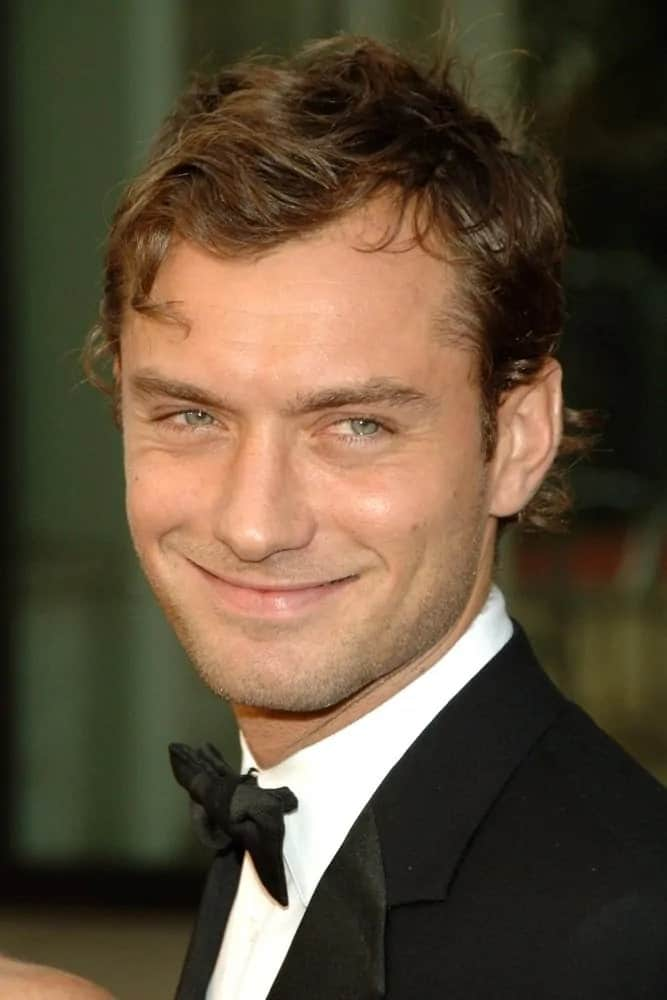 Jude Law paired his tousled blonde curls with a sheepish smile at the Metropolitan Opera Opening Night Gala of Madam Butterfly, Metropolitan Opera House at Lincoln Center, New York, NY in 2006.