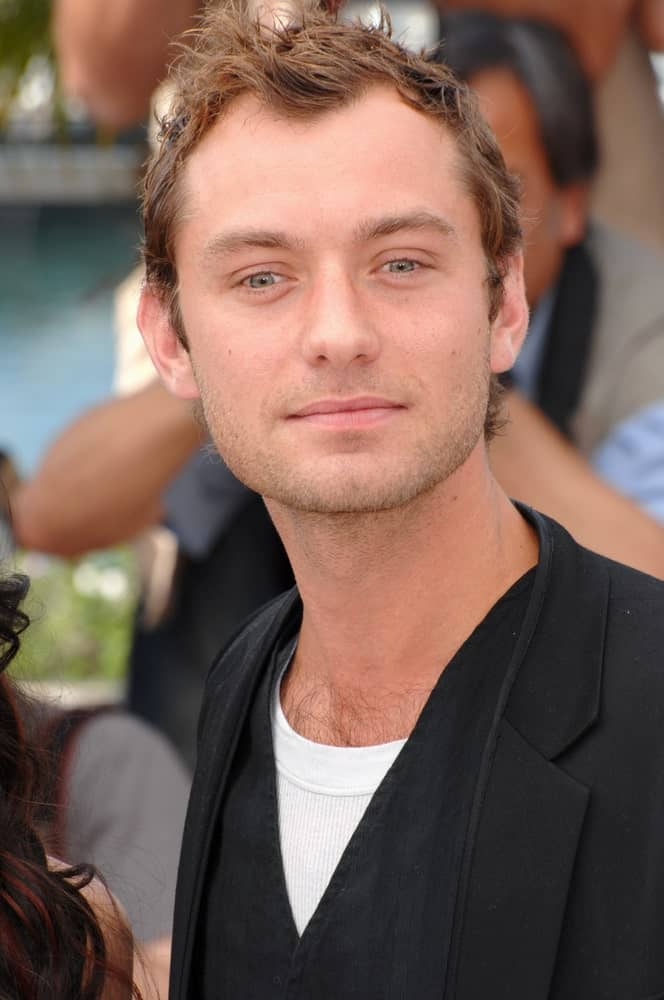 Jude Law had a short brown hair spiked and styled into a masterpiece at the photocall for his new movie