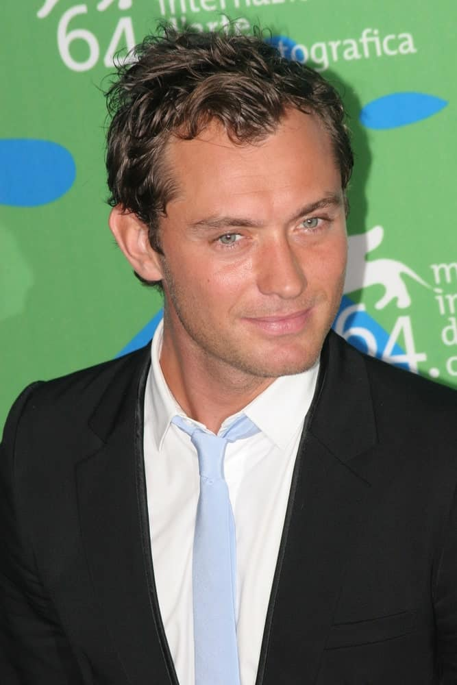 Jude Law's short dark hair was tossed into a wavy and spiky style when he attended the Sleuth photocall during Day 2 of the 64th Annual Venice Film Festival last August 30, 2007 in Venice, Italy.