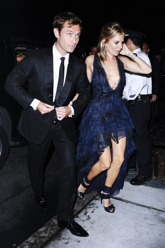 Jude Law and Sienna Miller enter The Mark Restaurant by Jean-Georges for the Celeberity Candids-Monday in New York City last May 3, 2010. Law was classy in his black suit and dark brown short curly hair.