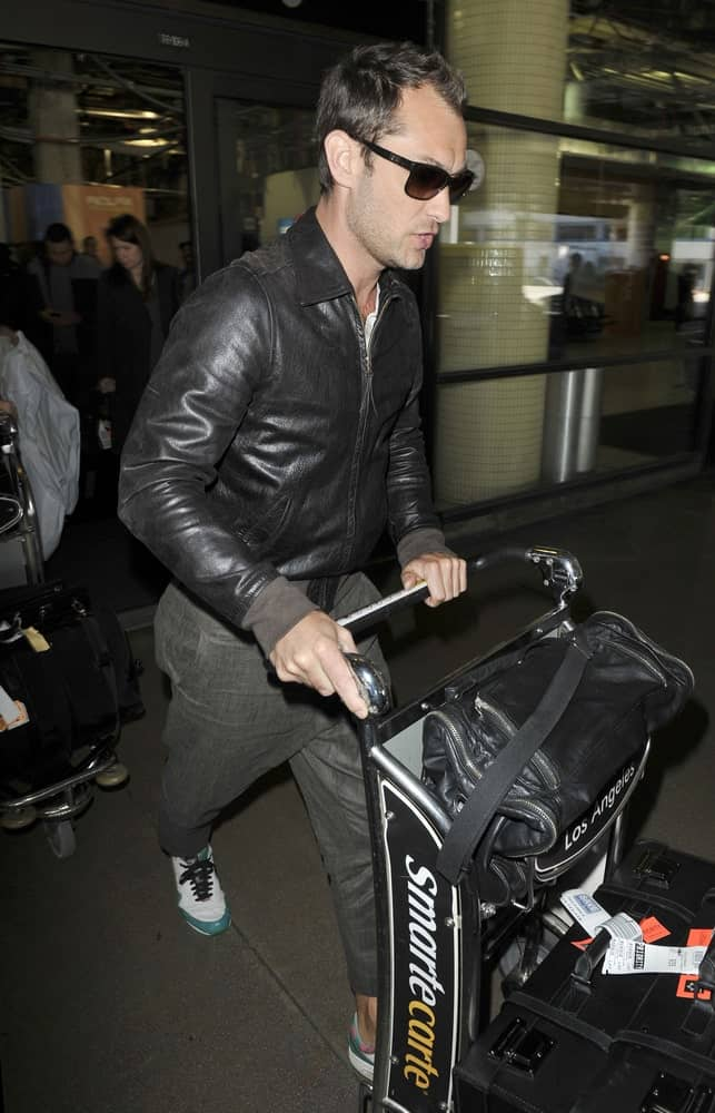 Actor Jude Law was seen at LAX last February 26, 2010 in Los Angeles, California wearing a casual leather jacket that complements his brushed up raven hair.