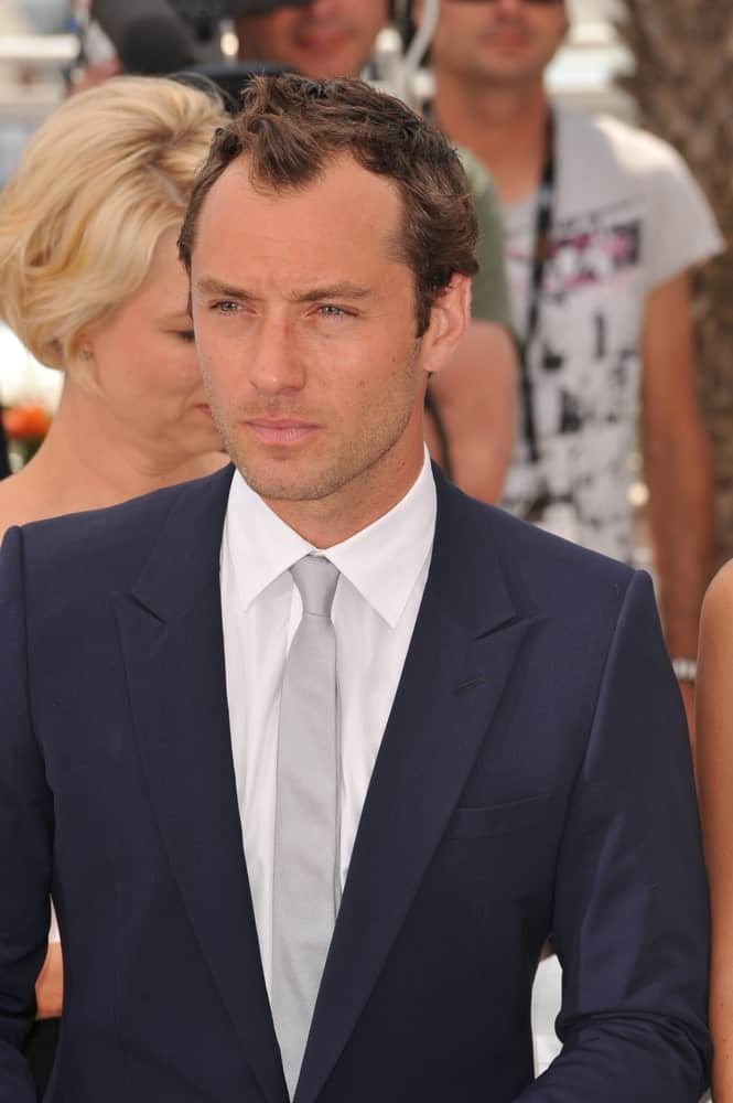 Jude Law's short crew cut hair with highlights were styled into waves and spikes at the photocall for The Jury at the 64th Festival de Cannes last May 11, 2011 in Cannes, France.