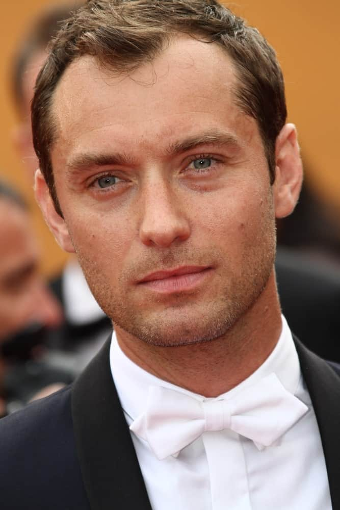 Jude Law looked elegant with his white bow tie and short spiky dark brown hair at the 'Pirates of the Caribbean: On Stranger Tides' premiere at the Palais des Festivals last May 14, 2011 in Cannes, France.