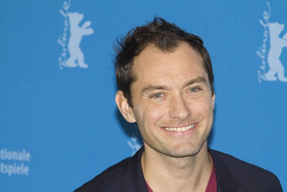 Actor Jude Law sported a raven tossed up hairstyle when he attended the 'Side Effects' Photocall during the 63rd Berlinale Festival at the Grand Hyatt Hotel on February 12, 2013 in Berlin, Germany.