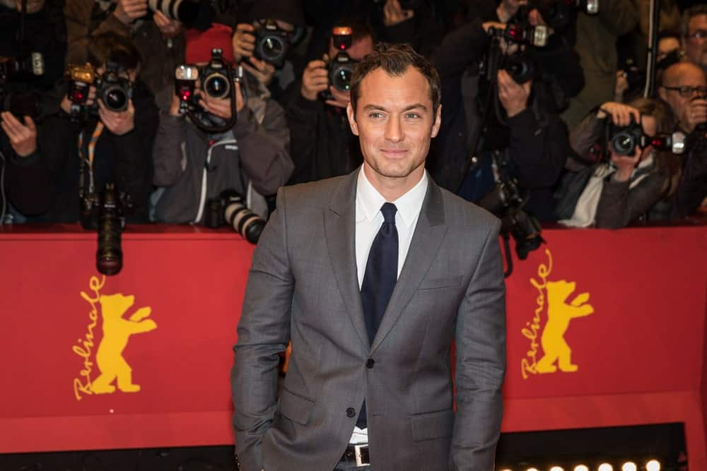 Last February 16, 2016, Actor Jude Law kept it classy and sexy in his dark gray suit and short hair with curly spikes at the 'Genius' premiere during the 66th Berlinale International Film Festival.