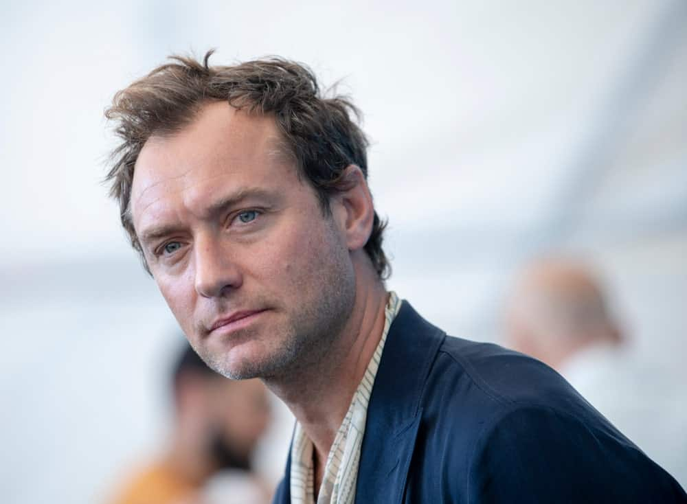 Jude Law sported a short and tousled hairstyle with highlights when he attended