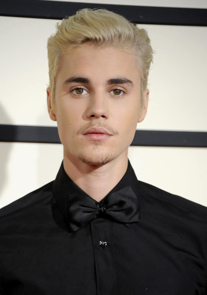 Justin Bieber dyed his hair platinum blonde and had it combed back for the 58th GRAMMY Awards held at the Staples Center in Los Angeles, USA on February 15, 2016.