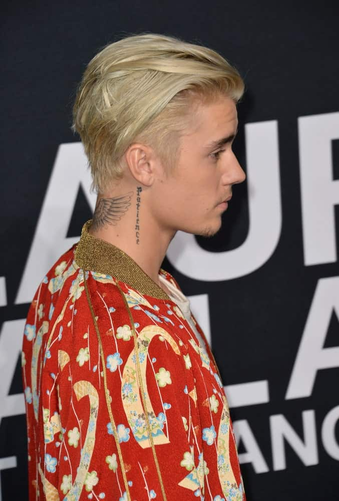 The singer arrived at Saint Laurent at the Palladium fashion show on February 10, 2016 with a long slicked back hair where sides are kept short to accentuate his tattoos.