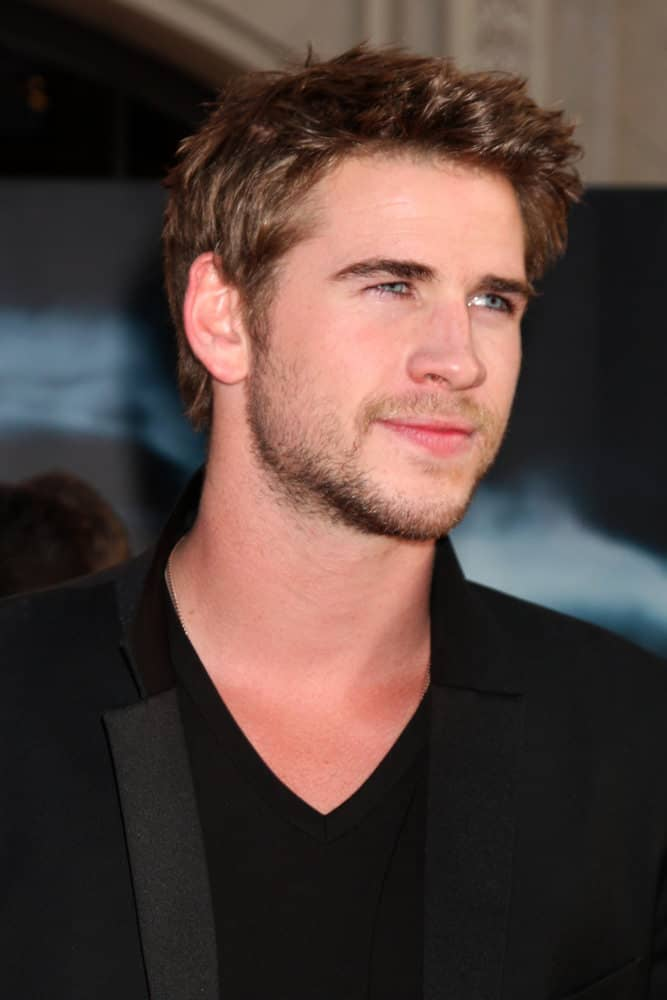 Liam Hemsworth trimmed his hair short when he appeared at the 2011 world premiere of