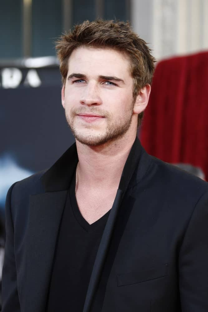 Liam Hemsworth sported a spiky hairstyle with his medium brown locks during the premiere of Thor at the El Capitan Theater, Los Angeles, California on May 2, 2011.
