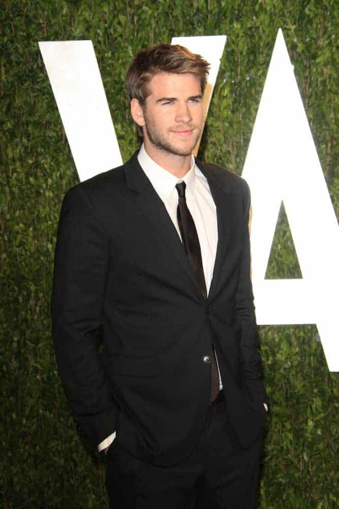 Liam Hemsworth cast a spell with his golden brown side-parted 'do during the Vanity Fair Oscar Party at Sunset Tower on February 26, 2012 in West Hollywood, California.