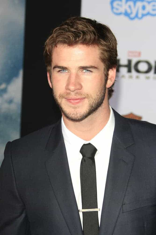 Liam Hemsworth had short hair with wavy bangs when he attended the premiere of