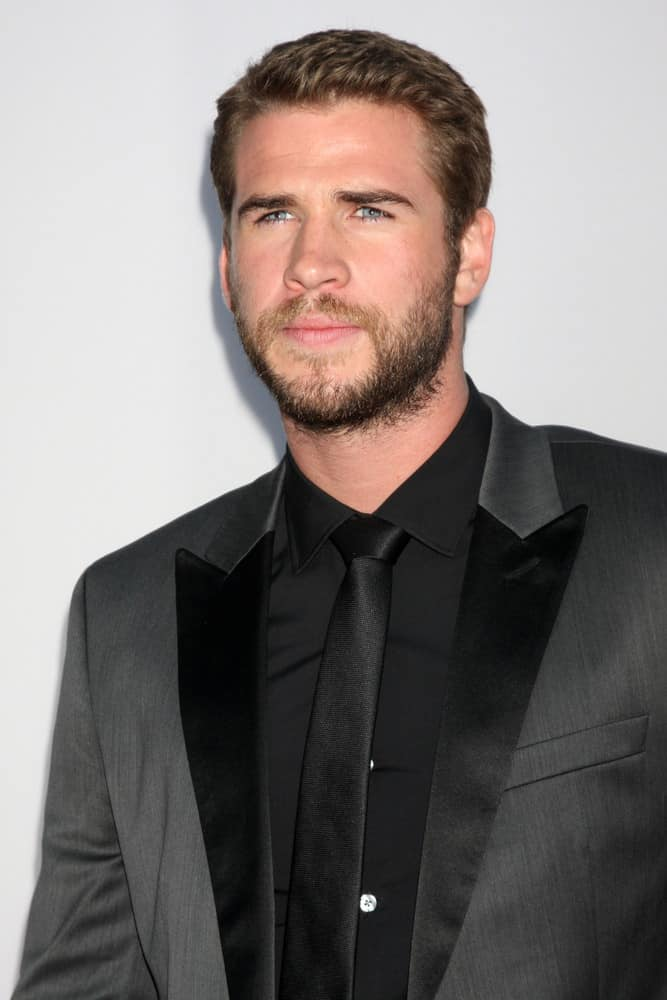 """Liam Hemsworth attended the Los Angeles premiere of """"Paranoia"""" in 2013 with mega short side parted hair."""