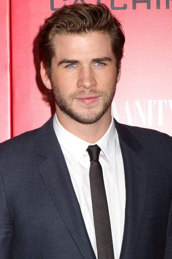"""Liam Hemsworth attended the premiere of """"Hunger Games: Catching Fire"""" at AMC Lincoln Square on November 20, 2013 in New York City with a short slicked hairstyle."""