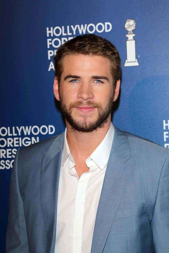 Liam Hemsworth cropped his hair short but kept a full beard on at the Hollywood Foreign Press Association's 2013 Installation Luncheon, Beverly Hilton, Beverly Hills, CA.