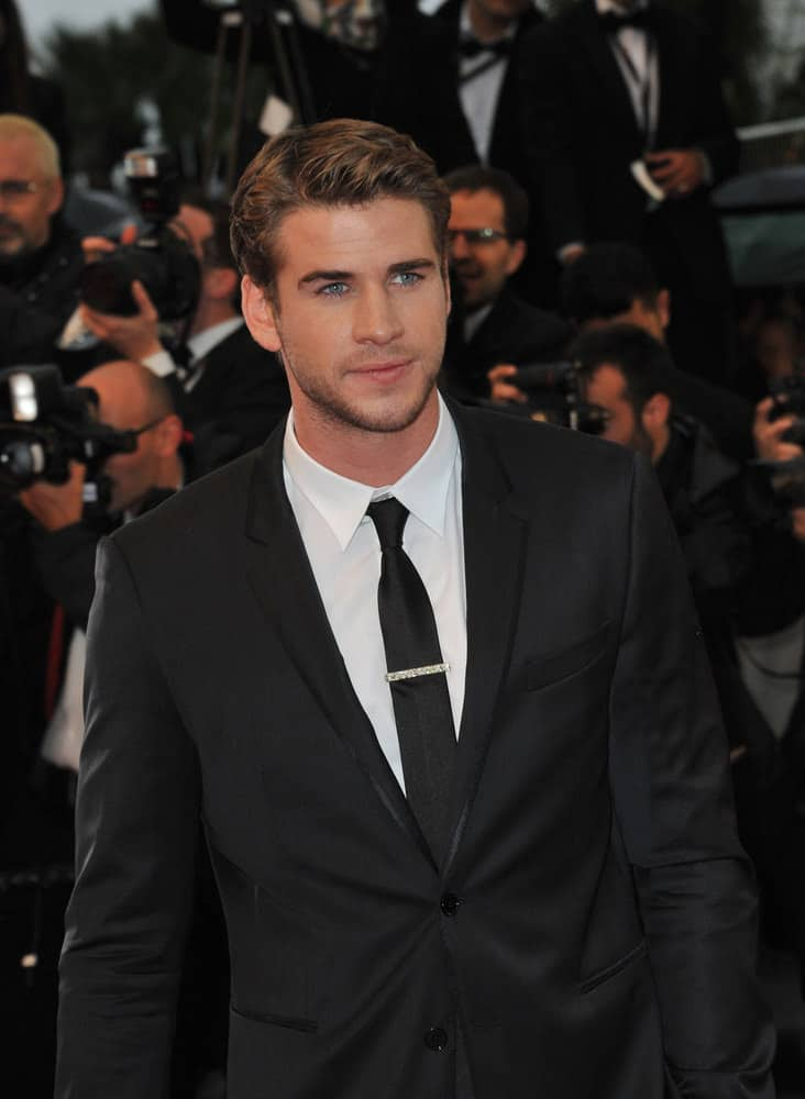 Liam Hemsworth looked dapper with side part hairstyle at the gala premiere of