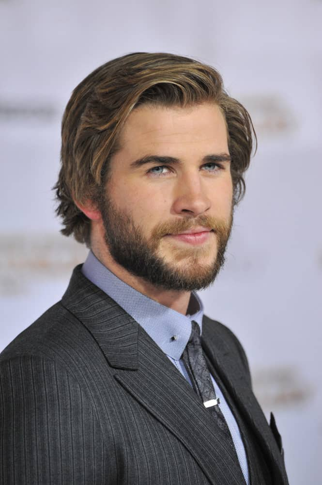 Liam Hemsworth looked manly with a full beard and medium-length layered hairstyle during the photocall of the 66th Cannes Film Festival for
