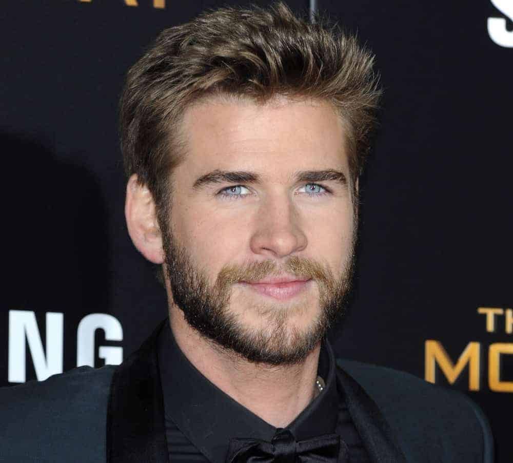 Liam Hemsworth appeared with short spiky hairstyle and a full beard at
