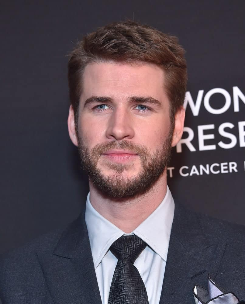 The actor had his short brunette hair brushed to the side during the Women's Cancer Research Fund's An Unforgettable Evening on February 28, 2019. It was complemented with a tight beard that gave his face a character.