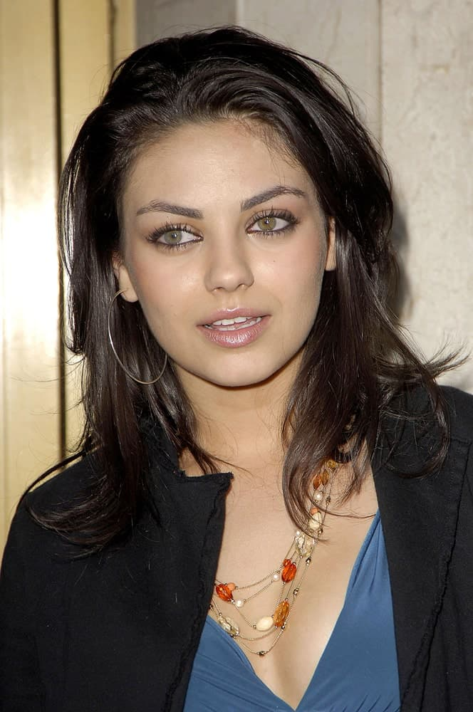 Mila Kunis was at the Family Guy's DVD Party held at the Mann's National Theatre in Los Angeles last September 27, 2005. She had a sexy ensemble outfit to match her tousled and loose raven layers.
