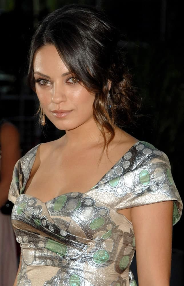 Mila Kunis stood out with her shiny and sexy dress at the Extract movie premiere in Los Angeles last August 24, 2009. She paired this dress with a messy low bun hairstyle with highlighted tendrils on the side.