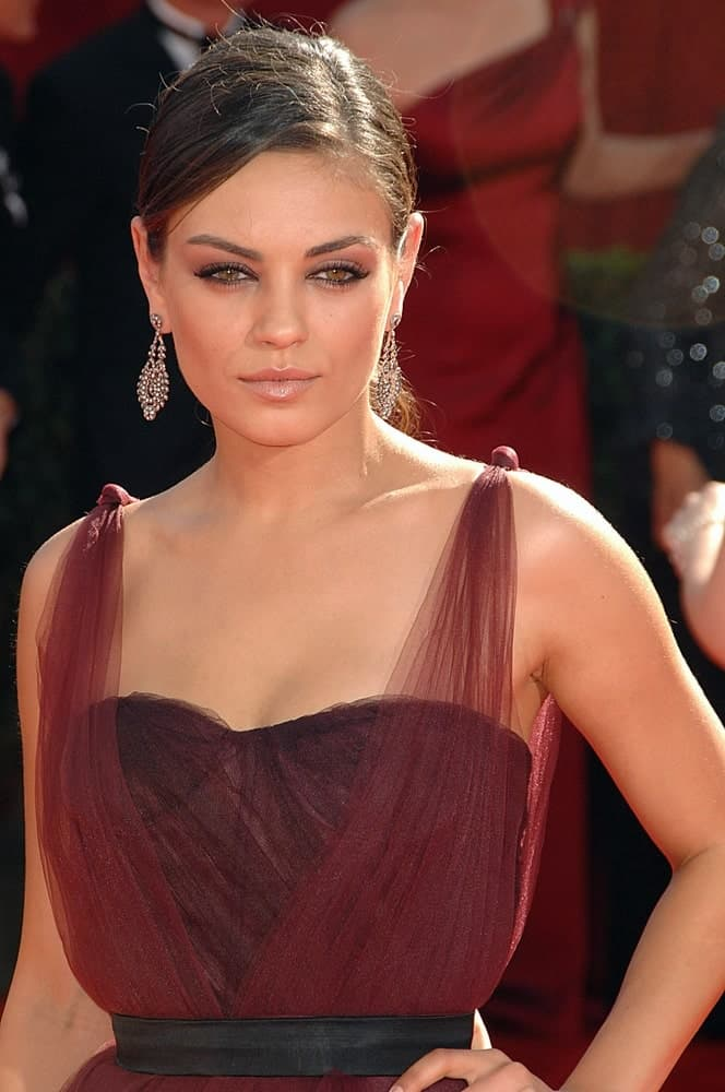Mila Kunis was wearing a Monique Lhuillier dress and Fred Leighton jewelry at the 61st Primetime Emmy Awards in Los Angeles last September 20, 2009. These complement her simple ponytail hairstyle with subtle highlights.