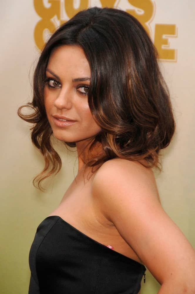 Mila Kunis was absolutely breathtaking with her black dress tousled waves with highlights at the Spike TV's Guys Choice Awards in Los Angeles last May 30, 2009.