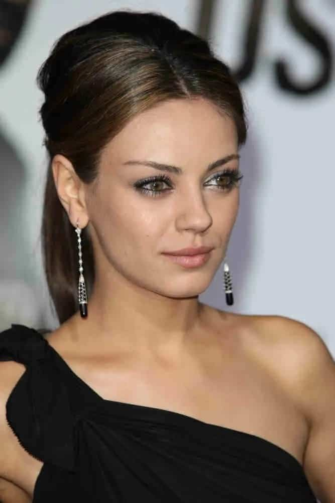 Mila Kunis was stunning in her goddess-like black dress that she wore with her slightly tousled ponytail and smoky eyes at The Book of Eli premiere last January 11 2010.