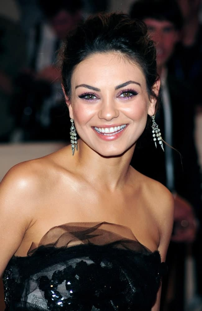 Mila Kunis was positively glowing in her detailed dark dress and messy upstyle hairdo that brings focus on her earrings and neckline. She wore this look at The Metropolitan Museum of Art in New York, May 3, 2010.