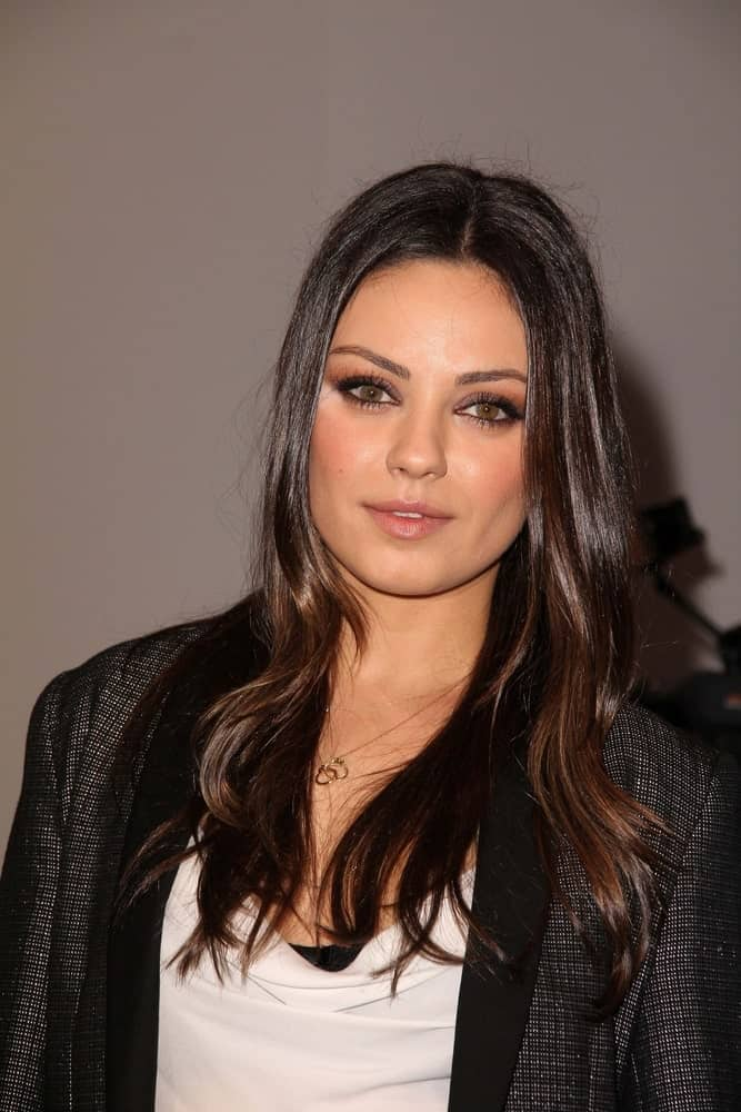 Mila Kunis was at the Jaguar Land Rover Preview Reception for the 2011 Los Angeles Auto Show in Beverly Hills last November 15, 2011. she wore a fashion-forward smart casual ensemble complemented by her long and loose straight hair with highlights.