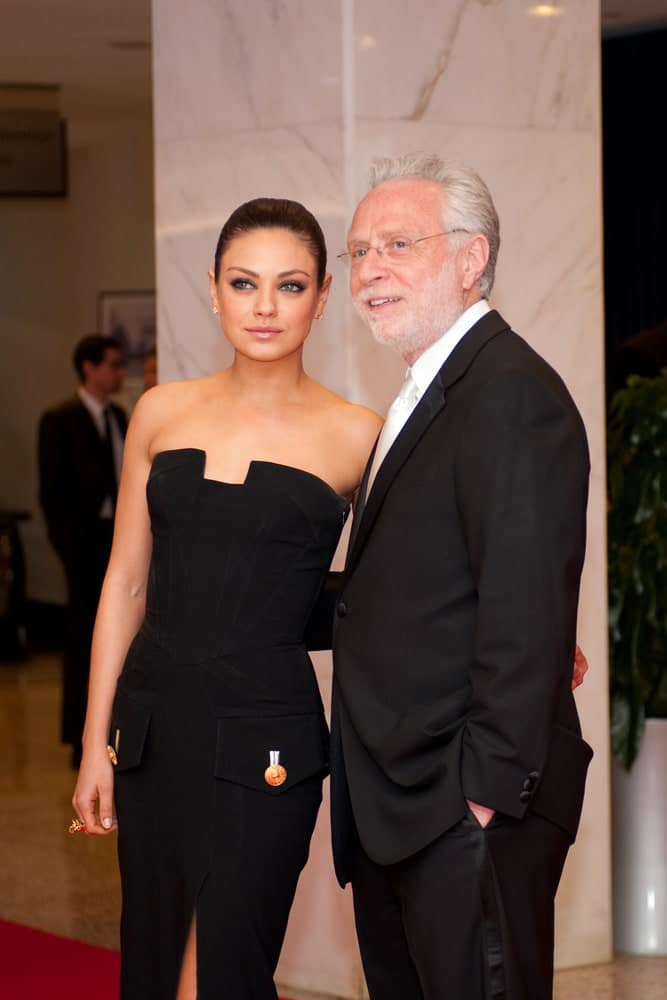 Mila Kunis and Wolf Blitzer arrived at the White House Correspondents Dinner last April 30, 2011 in Washington, D.C. She wore a formal yet elegant black dress elevated by her neat and slick upstyle hairdo.
