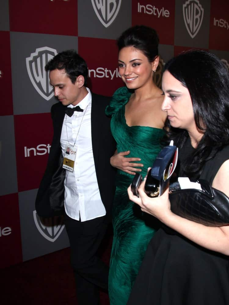 Mila Kunis was at the 12th Annual WB-In Style Golden Globe After Party last January 16, 2011 in Beverly Hills wearing a sophisticated green gown matched with her upstyle with a slight pompadour look.