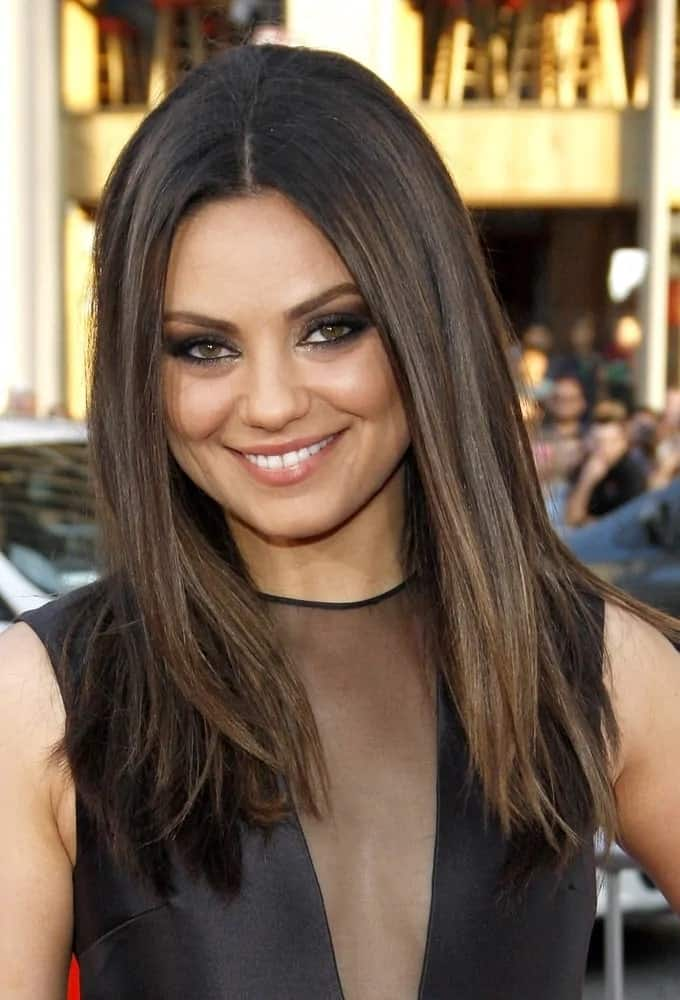 Mila Kunis was ravishing in her black dress with a deep V cut. She paired this with her fabulously loose, medium-length straight locks for the Los Angeles premiere of 'Ted' last June 21, 2012.