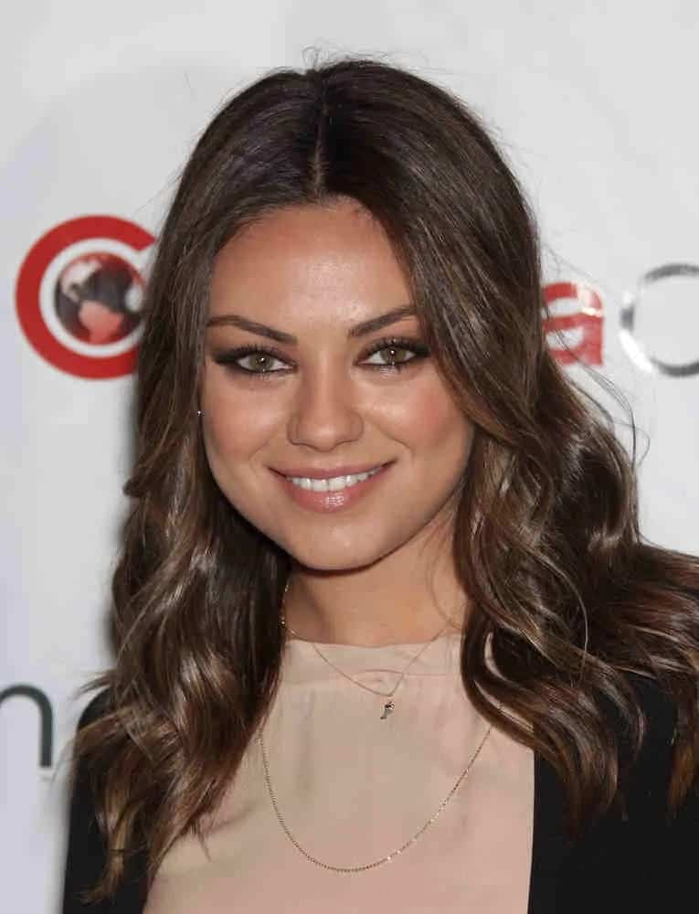 Mila Kunis was effortlessly stunning with her bright eyes and subtle highlights on her loose curls with a center part during the Cinema Con 2012-Disney Luncheon last April 25, 2012.