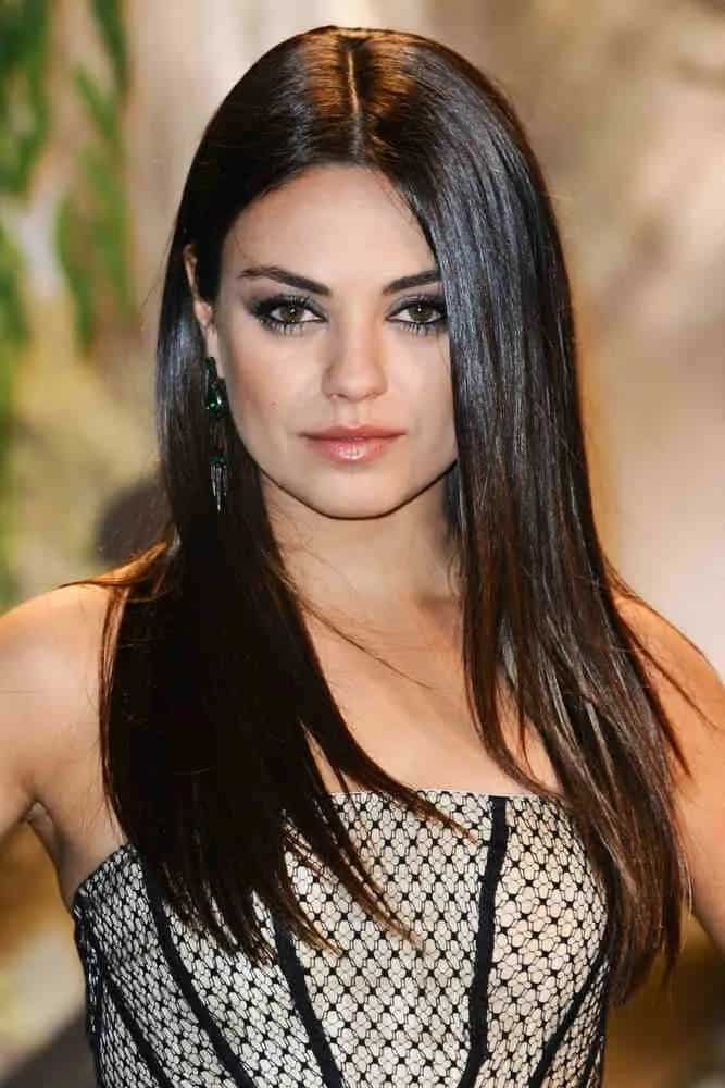 Mila Kunis showcased her long layered hair that is perfectly sleek and straight when she arrived for the premiere of