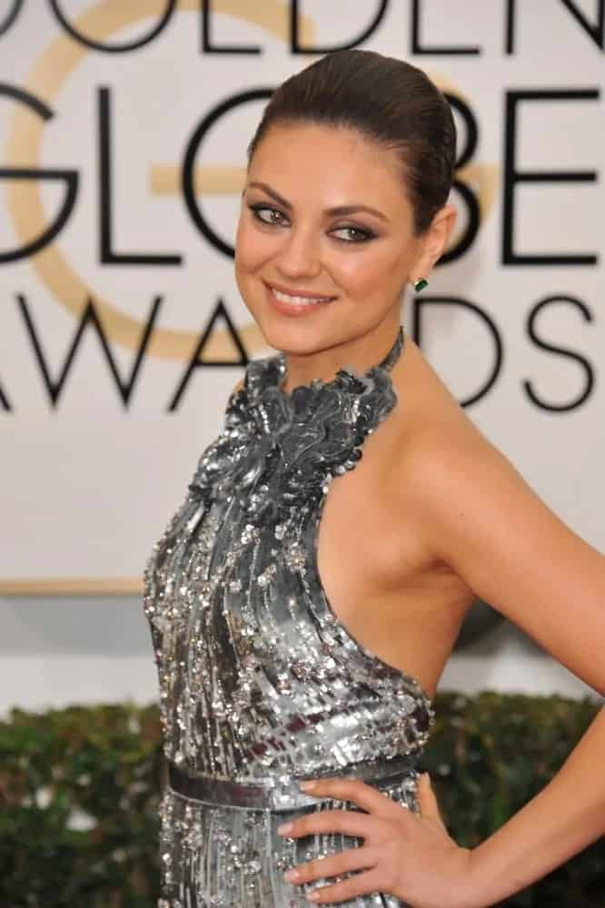 Mila Kunis was dazzling and bright in her sparkly and sexy dress that she paired with a slicked back low bun at the 71st Annual Golden Globe Awards last January 12, 2015.