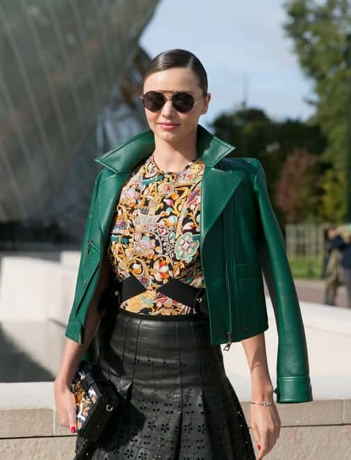 Nothing can beat Miranda Kerr's high fashion get-up matched with a sleek low ponytail during the Louis Vuitton fashion show at the Vuitton Foundation, October 7, 2015.