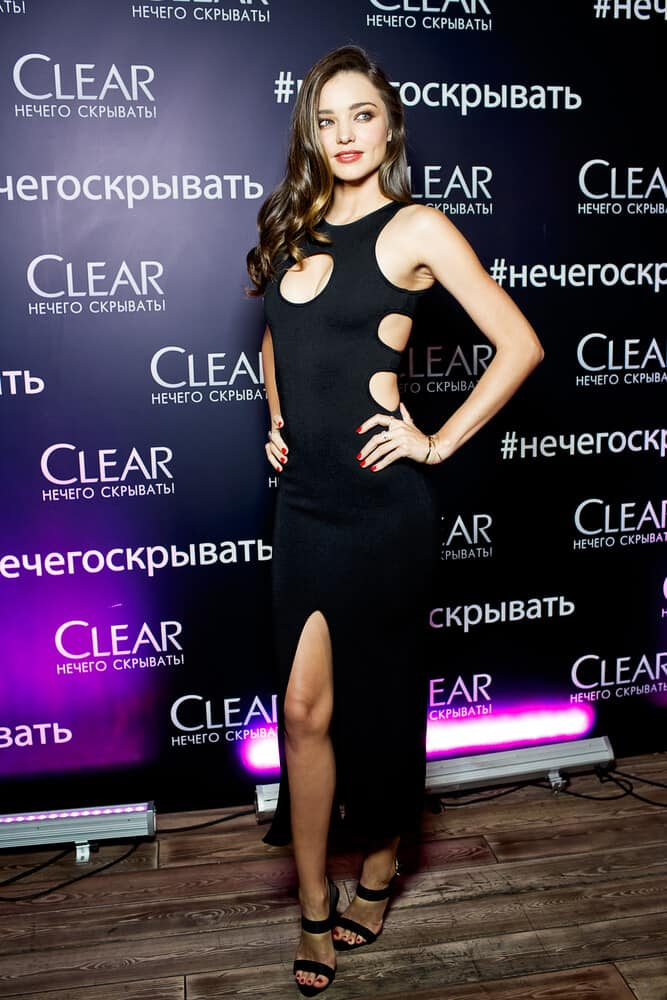 Miranda Kerr portrays her sexy side with her sleek night dress and bouncy curls during the photo call 'CLEAR, NECHEGO SKRIVAT' at the event of the Clear on June 15, 2015.