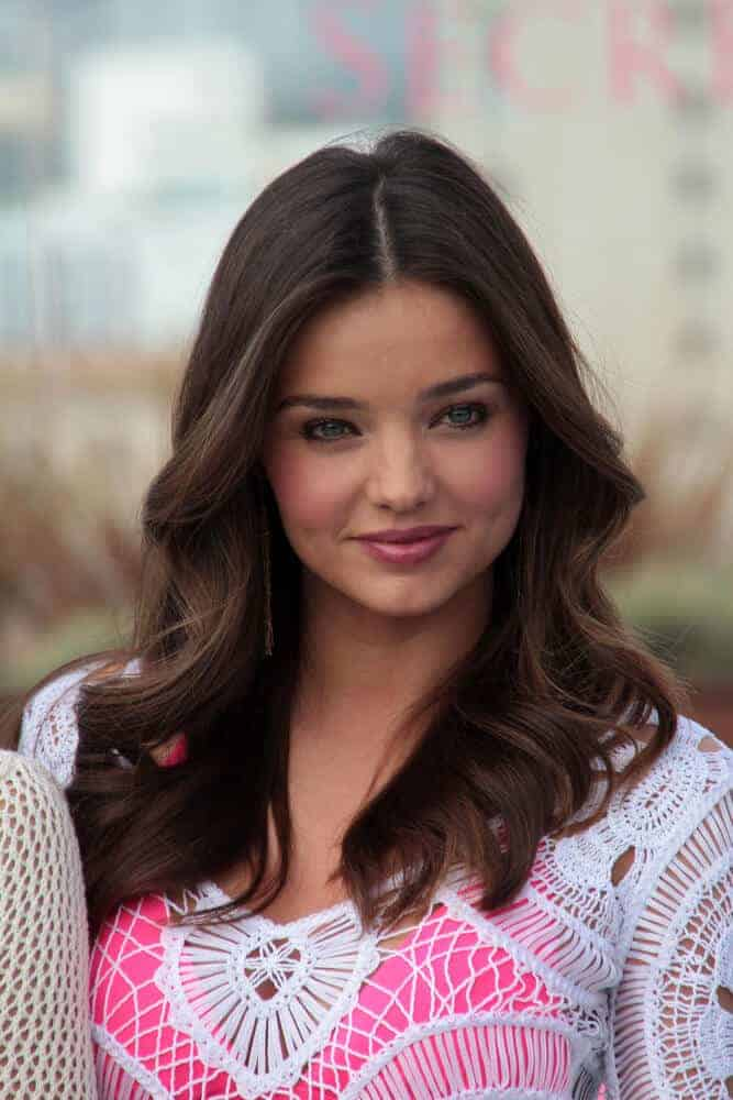 Miranda Kerr looking as youthful as ever with in this wavy, center-parted hairstyle she sported on the Victoria's Secret 2012 SWIM Collection.