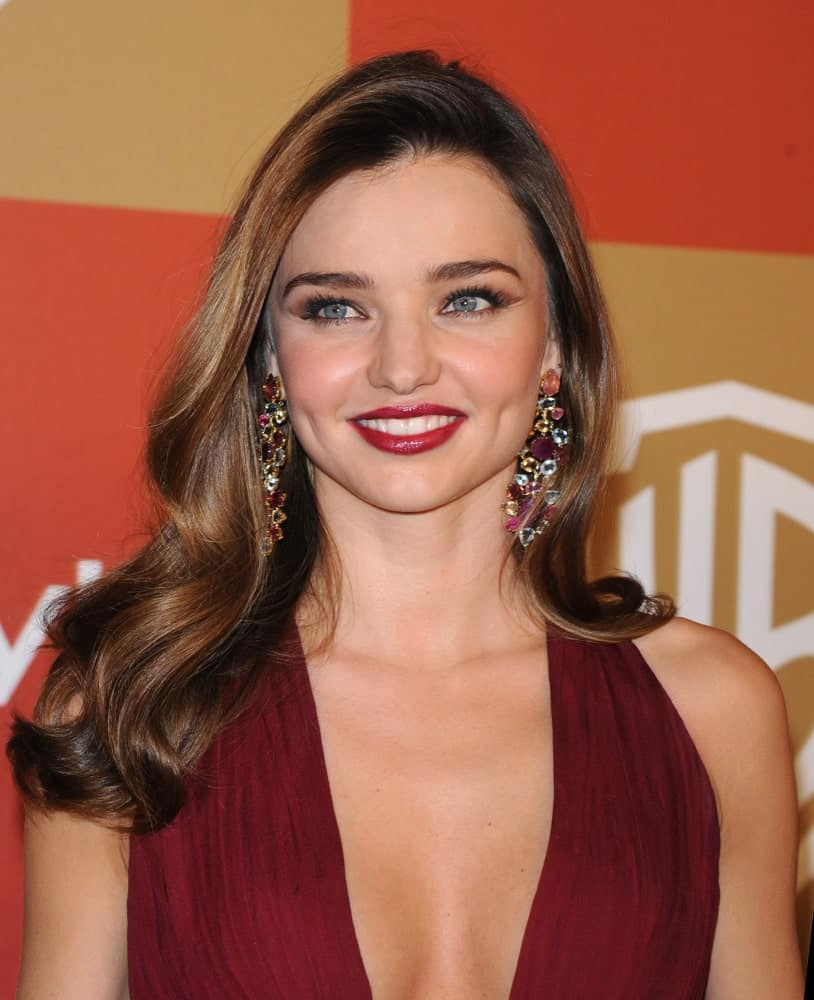 The model slayed the WB/In Style Golden Globe Party on January 13, 2013 with a side-swept hairstyle incorporated with soft and bouncy curls. She finished the look with a burgundy dress and gorgeous chandelier earrings.