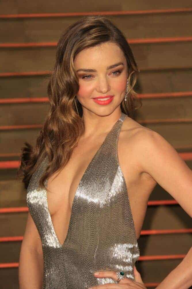 Miranda Kerr with long and loosely curled hair as seen on the 2014 Vanity Fair Oscar Party at the Sunset Boulevard on March 2, 2014.