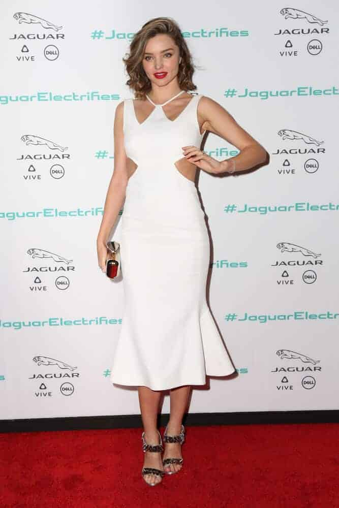 Miranda Kerr in her stunning white dress and tousled curls during the Unveiling Next Era Jaguar Vehicle at Milk Studios on November 14, 2016 in Los Angeles, CA.