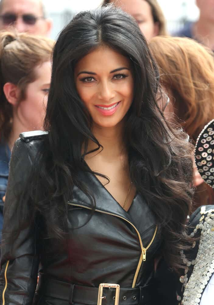 Nicole Scherzinger with center-parted curls went well with her leather outfit she wore during the The X Factor auditions held at London Excel London last June 19, 2013.