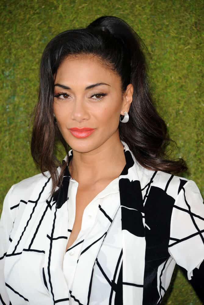Nicole Scherzinger in an extravagant look as she attended the 8th Annual Veuve Clicquot Polo Classic with this high-fashion ponytail incorporated with a thick, side tendril.