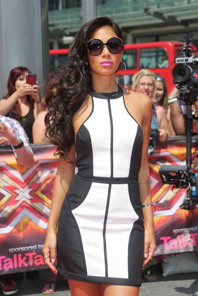 Nicole Scherzinger has always been sassy but this bouncy, side-swept curls made her look more confident than ever. This look, incorporated with a pair of fashionable sunglasses, caught everyone's attention during The X Factor London auditions held at Wembley arena, London., 2013.