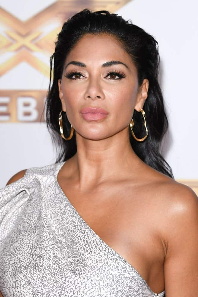 Nicole Scherzinger looked ravishing in a halter dress and gold hoop earrings accentuated by her slicked back hair. This was worn during the photocall for