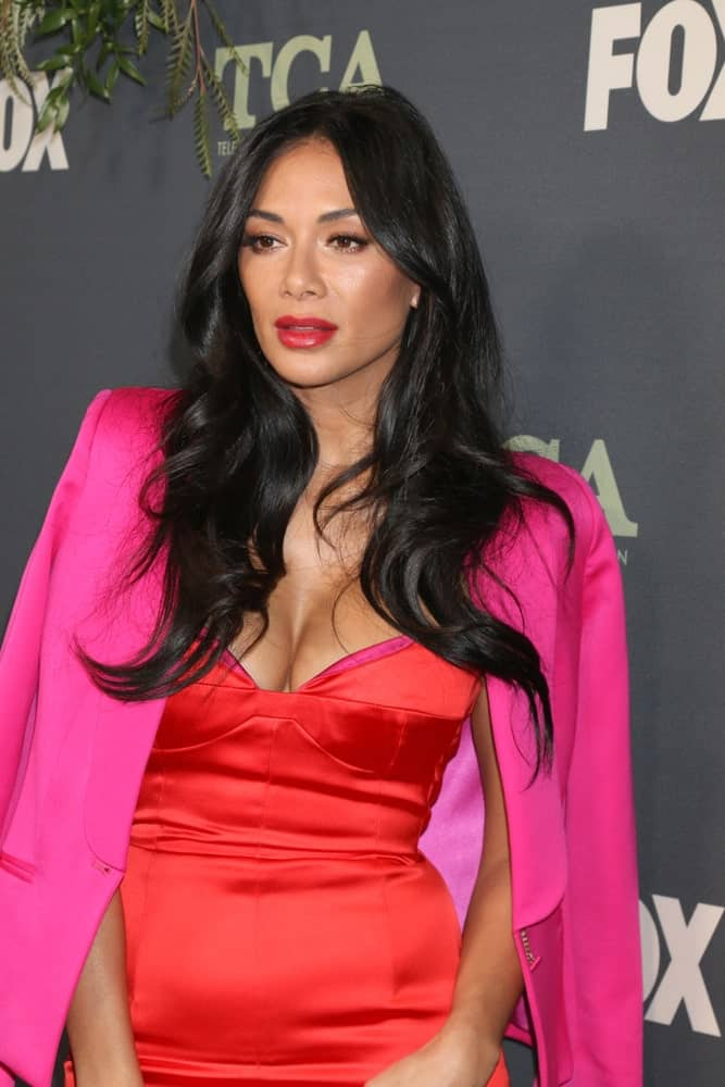 Nicole Scherzinger slayed the red carpet at the FOX TCA All-Star Party at the Fig House on February 1, 2019, with her voluminous black hair and a gorgeous red dress.