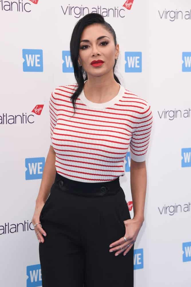 The actress shows off a casual attire with her low tied ponytail incorporated with a long side tendril. This sleek hairstyle was worn during WE Day 2019 at Wembley Arena, London held on March 6, 2019.