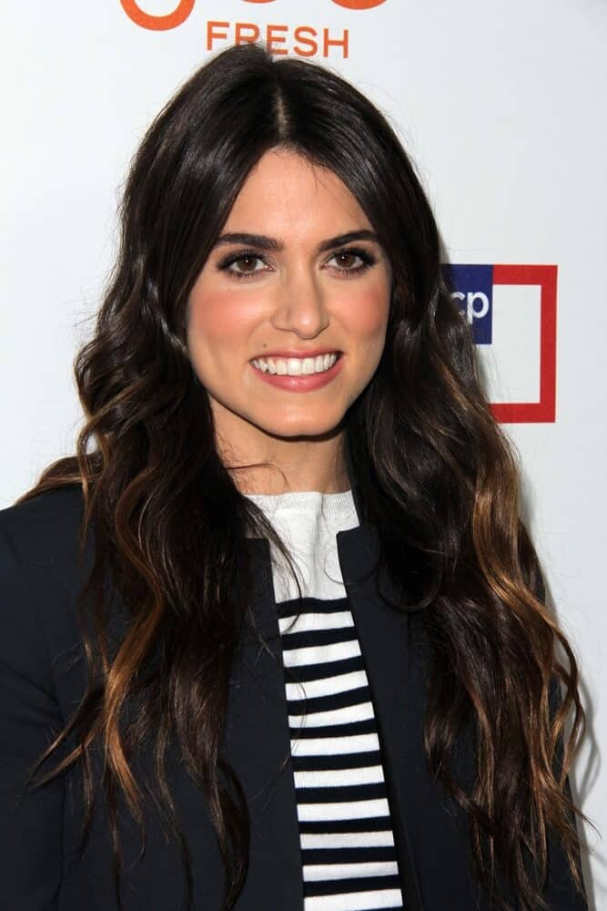Last March 7, 2013, Nikki Reed arrived at the introduction of Joe Fresh at JCP at JCP Pop Up Store in her casual but fashionable outfit paired with her thick and wavy hair in a loose style.